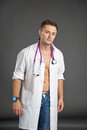 Portrait of a sexy young man in doctor costume Royalty Free Stock Photo