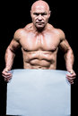 Portrait of shirtless man holding blank paper Royalty Free Stock Photo