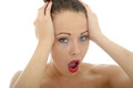 Portrait Of A Shocked And Upset Young Woman Holding Her Head In Royalty Free Stock Photo