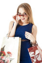 Portrait of shopping happy girls against white background Royalty Free Stock Images