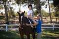 Portrait of sibling with horse Royalty Free Stock Photo