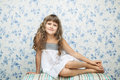 Portrait of sincere girl in sitting posture Royalty Free Stock Photos