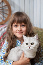 Portrait of sincere girl villager with cat on hand Stock Photography