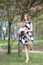 Portrait of slavic girl in spring in park with peonies. sakura blossom background Royalty Free Stock Photo
