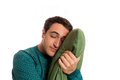 Portrait of a sleepyhead man in pajamas with its beloved pillow Royalty Free Stock Photo