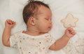 Portrait of slipping cure baby girl on the children linen Royalty Free Stock Photo