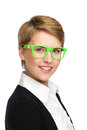 Portrait of a smailing beautiful young woman in green glasses. Stock Image