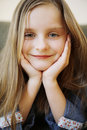 Portrait of small happy girl with long blond hair. Stock Image