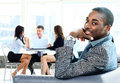 Portrait of smiling african american business man men with executives working in background Royalty Free Stock Images
