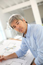 Portrait of smiling architect at office working in Royalty Free Stock Photos