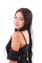 Portrait of smiling asian woman looking over shoulder white isolated background Stock Images