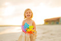 Portrait of smiling baby girl with windmill toy Royalty Free Stock Photo