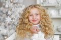 Portrait of smiling blonde little girl in Christmas decorated studio Royalty Free Stock Photo