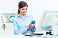 Portrait of smiling business woman call center operator at work young female model Stock Image
