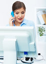 Portrait of smiling business woman call center operator at work young female model Royalty Free Stock Photos
