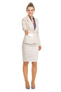 Portrait of smiling business woman giving business card full length Stock Photos