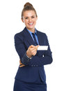 Portrait of smiling business woman giving business card high resolution photo Royalty Free Stock Image