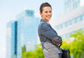 Portrait of smiling business woman in modern office district into the ultra trends Royalty Free Stock Photography