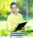 Portrait of smiling business woman with paper folder. Student Royalty Free Stock Images