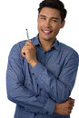Portrait of smiling businessman holding pen Royalty Free Stock Photo