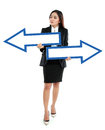 Portrait of smiling businesswoman with direction arrow sign on white background Stock Images