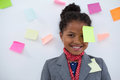 Portrait of smiling businesswoman with sticky notes stuck on head Royalty Free Stock Photo