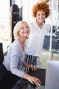 Portrait of smiling businesswomen at desk Royalty Free Stock Photo