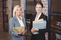 Portrait of smiling businesswomen holding documents Royalty Free Stock Photo