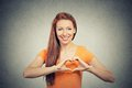 Portrait smiling cheerful happy woman making heart sign with hands