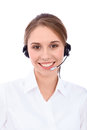 Portrait of smiling cheerful young support phone operator in headset,  over white background Royalty Free Stock Photo