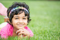 Portrait of a smiling child on green grass Stock Images