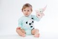 Portrait of a smiling child with a toy bear, isolated on a white background