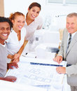 Portrait of smiling colleagues with blue prints Royalty Free Stock Photography