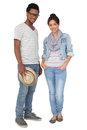 Portrait of a smiling cool young couple full length over white background Royalty Free Stock Photo
