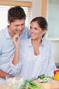Portrait of a smiling couple cooking Royalty Free Stock Photos