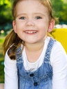 Portrait of smiling cute little girl outdoors Royalty Free Stock Photos