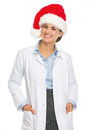 Portrait of smiling doctor woman in santa hat isolated on white Royalty Free Stock Images