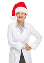 Portrait of smiling doctor woman in santa hat isolated on white Stock Image