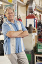 Portrait of smiling elderly man in automobile workshop men Stock Photography
