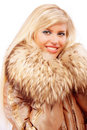 Portrait of smiling fair-haired woman in fur coat Stock Images