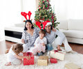 Portrait of a smiling family at Christmas time Stock Images