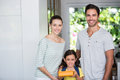Portrait of smiling family with daughter holding lunch box Royalty Free Stock Photo