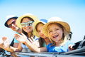 Portrait of a smiling family with two children at beach in the c Royalty Free Stock Photo