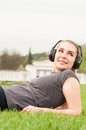 Portrait of smiling female on sunny summer day listening music Royalty Free Stock Photo