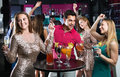 Portrait of smiling females and males having fun in the bar Royalty Free Stock Photo
