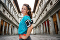 Portrait of smiling fitness woman with mp3 player, Florence Royalty Free Stock Photo