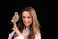 Portrait of smiling girl with bird on the hand Royalty Free Stock Photography
