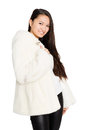 Portrait of a smiling girl in a fur coat mixed race asian caucasian Stock Photos