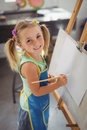 Portrait of smiling girl panting on canvas Royalty Free Stock Photo