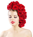 Portrait of smiling girl with red roses hairstyle isolated on wh white background Royalty Free Stock Photos